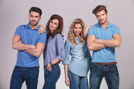 polo shirt: relaxed group of casual young people standing on grey studio background