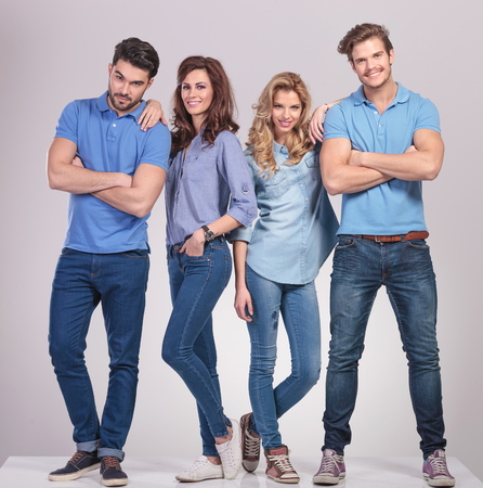 lean on hands: casual men standing with hands crossed and women lean on them on grey studio background