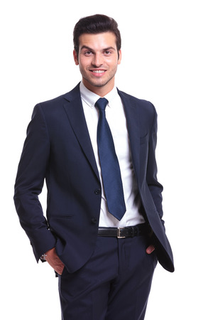 elegant business man smilling and holding his hand in the pocket while smiling to the camera photo