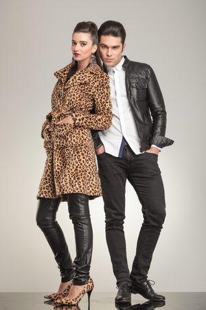 body image: Fashion couple looking at the camera while holding their hands in pockets, ful body image.