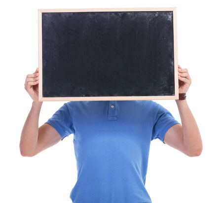 chalk board background: picture of a young casual man holding a blank blackboard in front of his face. isolated on a white background