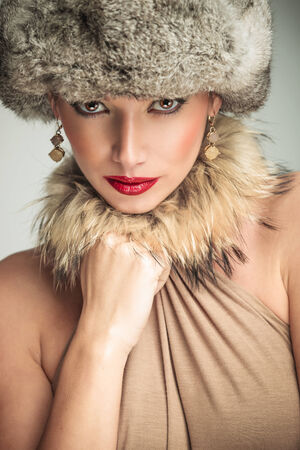 glamour beauty woman wearing fur har and collar looking at the camera photo