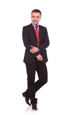 Full body picture of a young business man posing on white studio background, isolated. Stock Photo