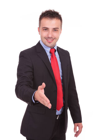Portrait of a young business man holding his hand up for a handshake. photo
