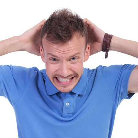 exasperated: picture of a young casual man with an exasperated expression. isolated on a white background