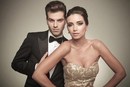 close p: Close p picture of a elegant couple posing on studio background, both looking at the camera. Stock Photo