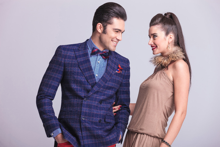 each other: Young happy fashion couple looking at each other while smiling. Stock Photo