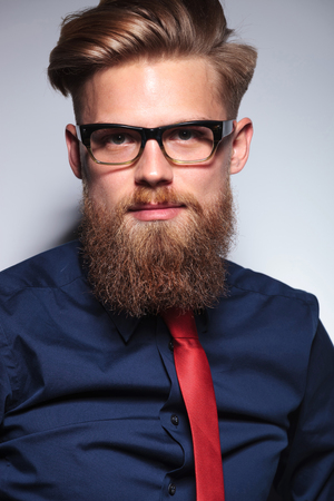 long beard: Close up picture of a long beard business man on grey studio background. Stock Photo