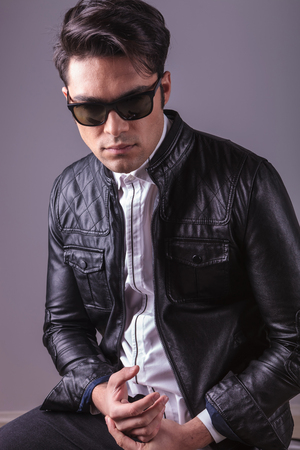 casual fashion: Portrait of a casual fashion man wearing sunglasses and leather jacket.