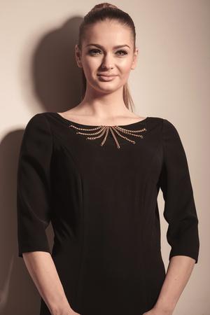 gorgeous businesswoman: Portrait of a gorgeous blonde woman posing on grey studio .