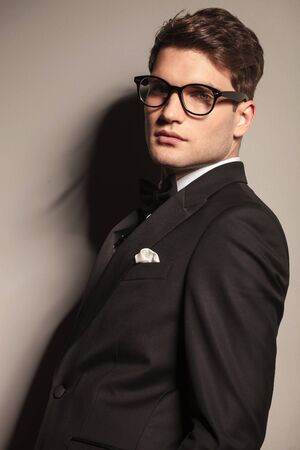 Close up picture of a handsome young elegant business man wearing glasses. photo