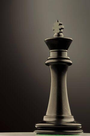 chess king: Chess King piece, on grey studio background