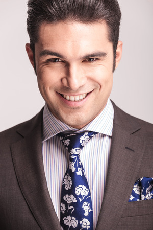 man face close up: Close up picture of a handsome young elegant business man smiling to the camera. Stock Photo