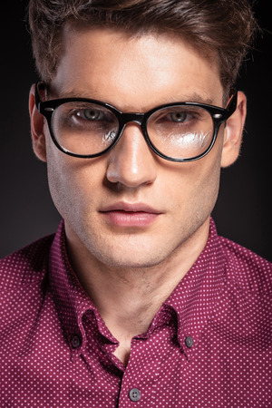 smile close up: Portrait of a casual handsome man wearing glasses.