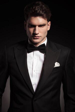 tux: Portrait of a handsome elegant man wearing a black tux. Stock Photo