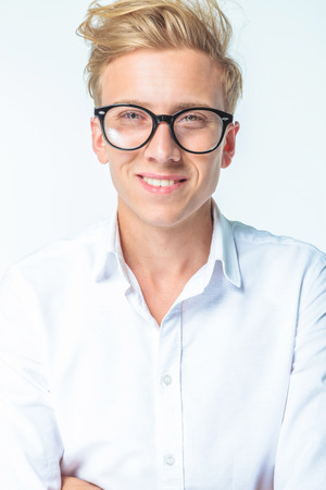 Portrait of a smiling young man wearing glasses.
