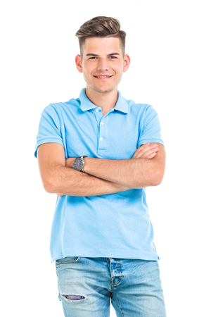 mani incrociate: Portrait of a young man smiling while holding his hands crossed.