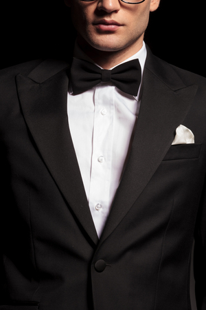 potrait: Potrait of a man wearing a tuxedo.