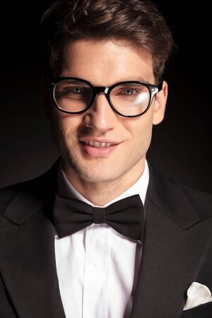 tuxedo man: Close up picture of a elegant young man smiling to the camera.