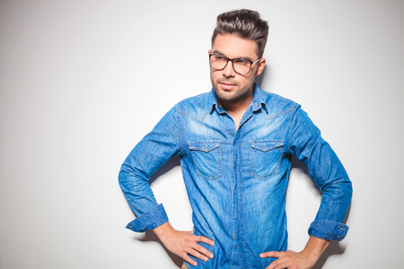 young style: portrait of man with glasses wearing denim shirt Stock Photo