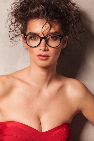 provocative: Close up picture of a provocative young woman wearing glasses. Stock Photo