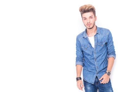 men standing: portrait of a young casual man in jeans clothes posing on white background Stock Photo