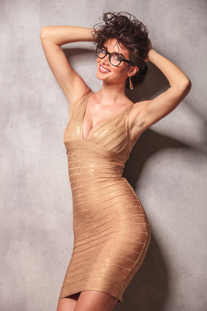 decolletage: sexy woman wearing glasses, pose while holding her hair with both hands Stock Photo