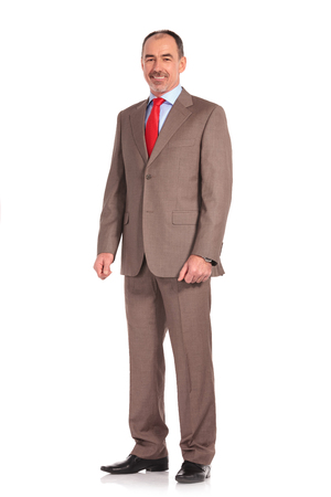 full body picture of a mature senior businessman standing on white background