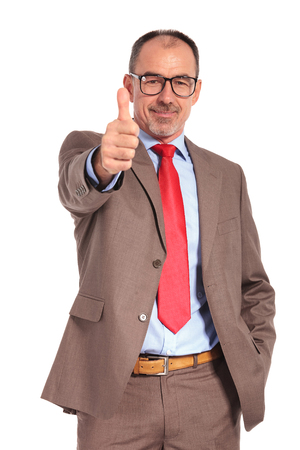 making up: smiling old businessman making the ok thumbs up hand sign on white background