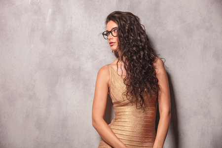 provocative woman: beautiful young woman wearing glasses pose looking away with her hands down Stock Photo