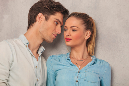 each: portrait of couple looking at each other in studio background
