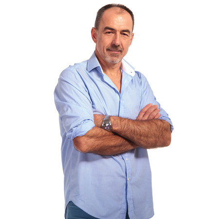 mature smart casual man posing smiling whith hands crossed in white isolated studio background 版權商用圖片