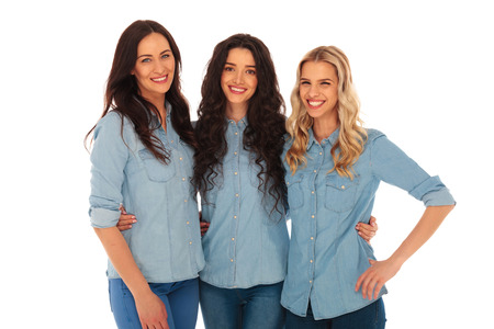 women having fun: three young casual women having fun together, on white background Stock Photo