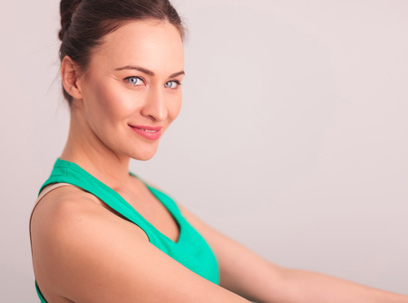 undershirt: side view of a happy woman in green undershirt looking at the camera Stock Photo