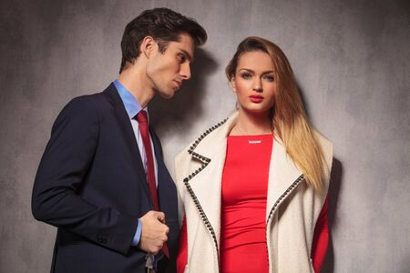 together with long tie: business man looking at his woman dressed in red dress