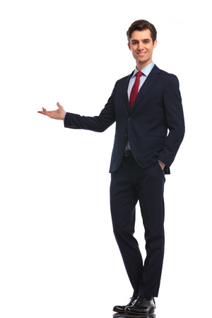 happy businessman presenting something on white background 스톡 콘텐츠