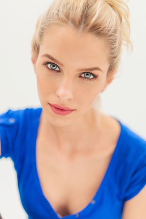 blond girl: beauty portrait of a blonde woman with blue eyes looking at the camera