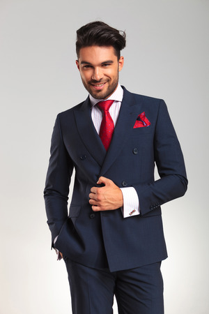 double breasted: successful young business man in double breasted suit smiling at the camera