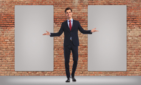 two hands: happy business man inviting you to see his twon blank big billboards Stock Photo