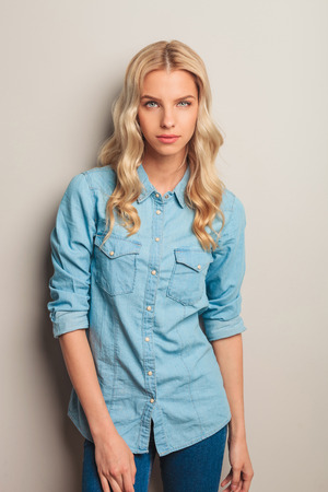 portrait of a young casual blonde woman posing in studio