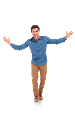 laughing excited man welcoming you, full body picture of white background