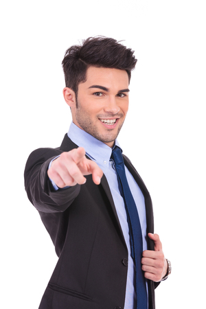 smiling businessman pointing his finger to the camera on white background photo