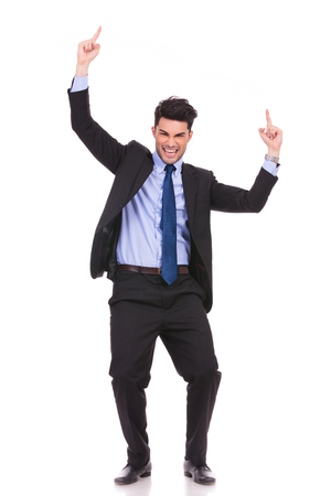 young businessman celebrating success with hands up in the air on white background photo