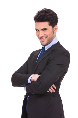 happy young business man with hands crossed smiling to the camera on white background photo