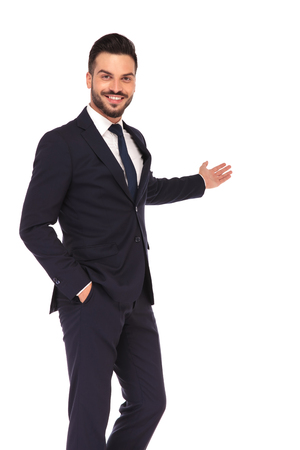 happy young business man presenting and smiling on white background