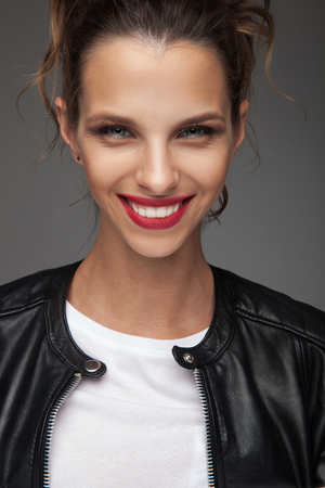 young beautiful woman smiling for the camera in studio Banco de Imagens