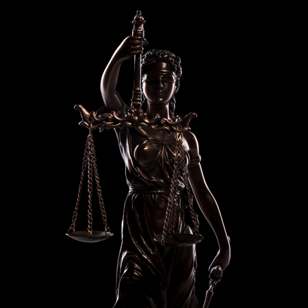 statue of the goddess of justice on black background