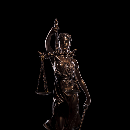 justice is blind, small statue of the goddess on black background Stock Photo