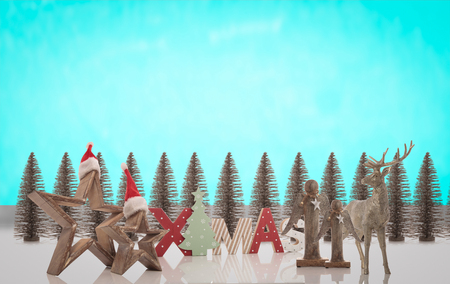 montage of christmas decoration against blue sky like background