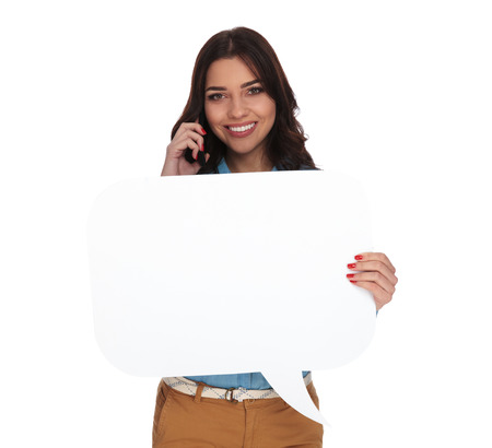 smiling woman talking on the phone and holding a speech bubble on white backgroound